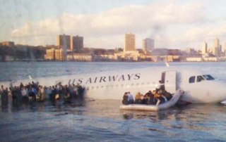 Passengers try to scramble off the doomed airliner before it sinks